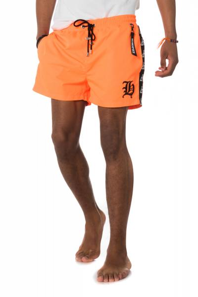 Short orange fluo homme              title=