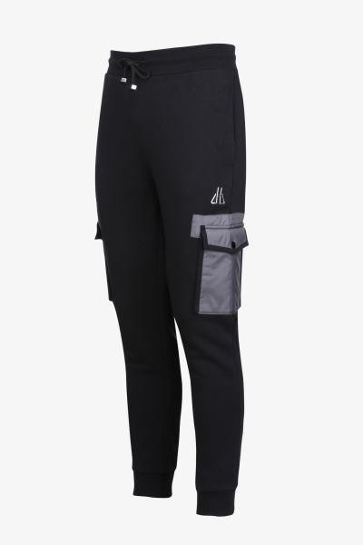 Pantalon sportswear noir et gris              title=