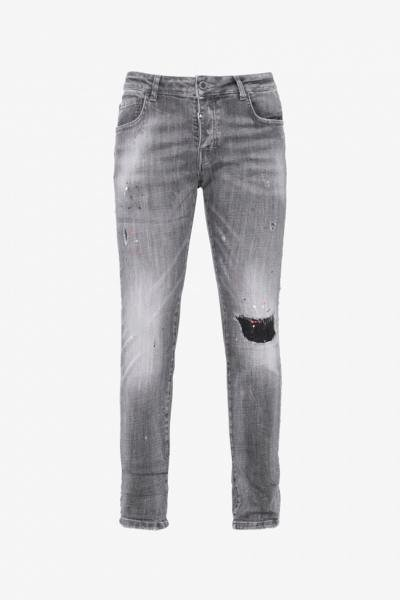 Jean gris effet usé coupe ajustée
